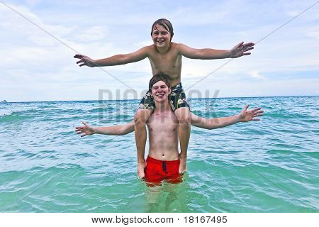 brothers having fun in the beautiful clear sea