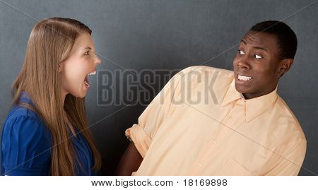 Man Frightened By Angry Woman