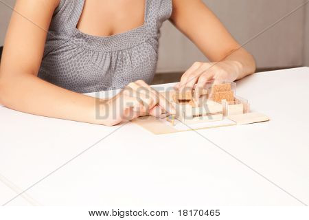 A detail of a interior designer working on a model house