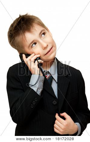 Boy in Suit talking on a cell phone