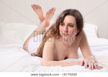 Beautiful Young Topless Woman Lying On Bed