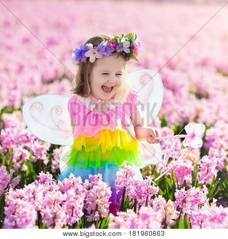 Little Girl In Fairy Costume Playing In Flower Field poster  sc 1 st  PrintMePoster.com & Little Girl In Fairy Costume Playing In Flower Field Poster ID:181960663