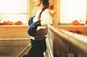 Beautiful Boxing Girl In Blue Gloves Posing In The Ring. Training At The Gym. Sporty Female Doing Bo poster