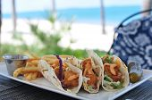 stock photo of mahi  - Plate of Fish Tacos served at the Beach - JPG