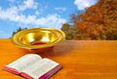 image of tithe  - Offering plate on table with bible and bright background - JPG