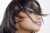 picture of young black woman  - attractive young black woman with hair whisking across her face - JPG