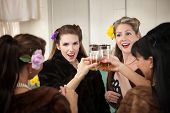 picture of foursome  - Group of four Caucasian housewives raise a toast in a kitchen - JPG