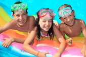 pic of swimming pool family  - Happy kids in the pool - JPG