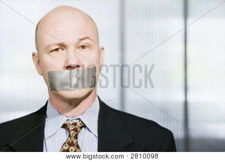Muzzled Businessman