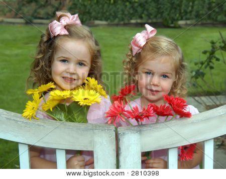 Adoring Sisters Bring Flowers