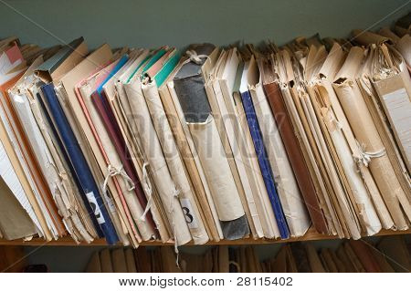 Archival documents folders on the shelves