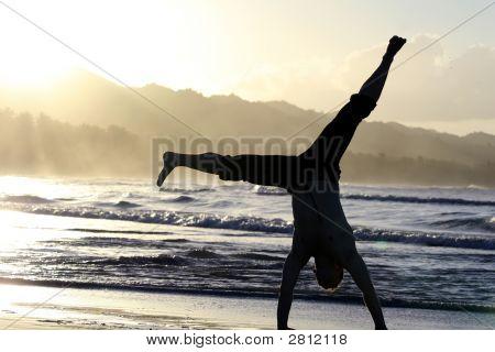 Man Turns Cartwheels On The Beach