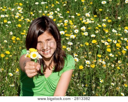 Happy Smiling Child Giving Flowers