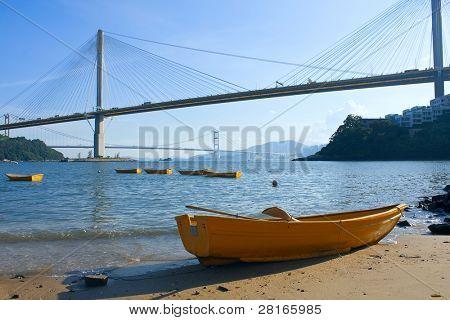 boat on the beach under the bridge