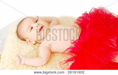 A Beautiful  Smile  Ballet  Baby Laying On A Fur Rug