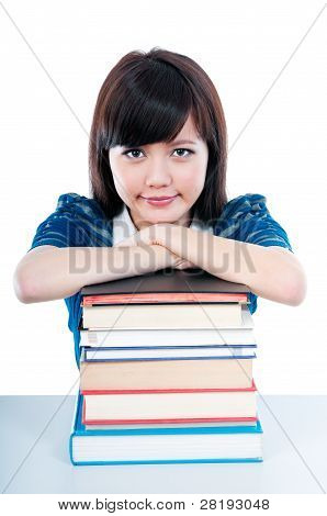 Cute Student Resting On Books