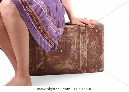 Woman Sitting On Old Suitcase
