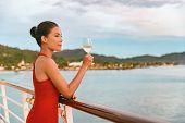 Luxury cruise ship travel elegant Asian woman drinking wine glass drink enjoying watching sunset fro poster