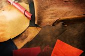 Selecting leather. Leather craft. Colorful pieces of beautifully colored or tanned leather on leathe poster