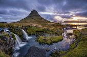 Cloudy Sunrise At The Most Iconic Waterfall In Iceland, The Kirkjufellsfoss In The The Snaefellsnes  poster