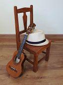 A Samba Player (sambista) Hat And A Cavaquinho (a Small Brazilian String Musical Instrument) On A Sm poster