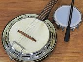 Close-up Of Two Brazilian Musical Instruments: Samba Banjo And Tamborim With Drumstick On A Wooden S poster