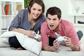 foto of concubine  - Young couple playing a video game together - JPG