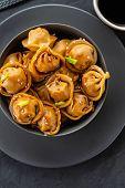 Asian Dumplings In Bowl, Chopsticks, Plates. Asian Table Setting. Chinese Dumplings For Dinner. Sele poster