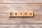 Detox Word Written On Wood Block. Detox Text On Wooden Table For Your Desing, Concept poster