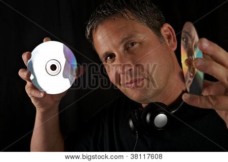 Male DJ's Reflection in CDs
