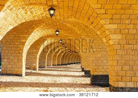 The Arched Stone Colonnade With Lanterns
