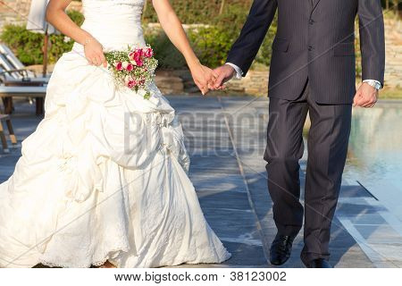 Couple Walking After Wedding Ceremony