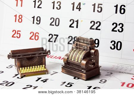 Cash Register And Typewriter On Calendar Pages