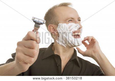Man Demonstrating Shaving Razor