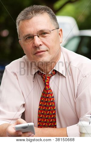 Portrait Of Businessman With Smart Phone
