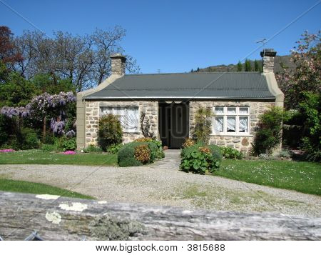 Old Cottage And Garden