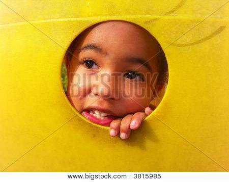 Young Child Peeking Through A Hole