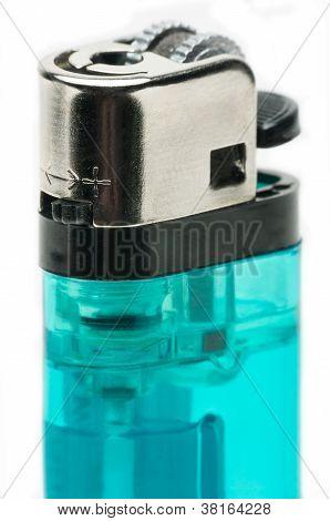 Macro Shot Of A Blue Butane Lighter On White.