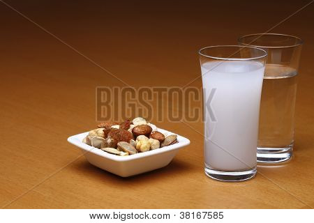 Raki and water with dried fruits