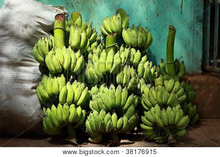 Green Banana Bunches In Local Bazaar In India.
