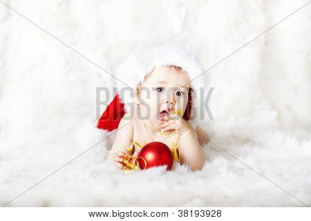 Christmas Baby In Red Santa Claus Hat