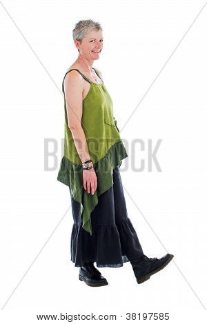 Happy Older Woman Stands In Loose Flowing Long Dress