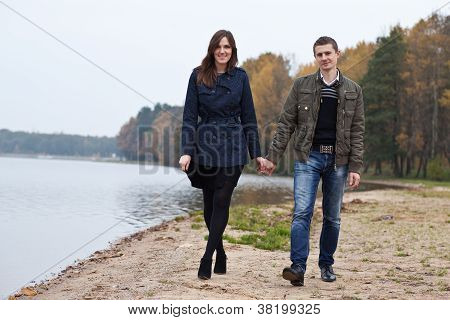 Young Couple Walking On Lake