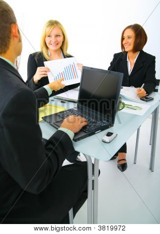 Businessteam Discussing Sales Chart