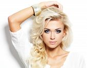 stock photo of grey-haired  - Beautiful blond woman with long curly hair and style makeup - JPG