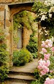 Stairs To The Garden Into Medieval Castle In England In Summer Day poster
