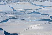 stock photo of growler  - Frozen sea with big ice floes in the Netherlands - JPG