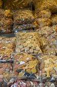 foto of bag-of-dog-food  - Plastic bags filled with dog food on sale on a market stall - JPG
