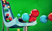 stock photo of gumballs  - gumballs sliding down isolated on green background - JPG