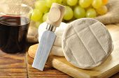picture of tomas  - Italian tomino cheese on a wooden chopping board italian appetizer - JPG